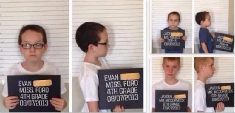 kids posing like they're in jail with signs for the first day of school